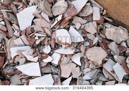 Construction Waste. A Pile Of Construction Waste, Closeup. Building Rubble And Stones. Abandoned Gar