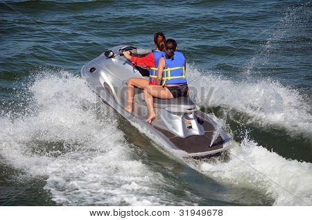 Two Young Women Riding a Jet Ski