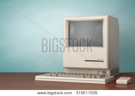 Retro Personal Computer. The System Unit, Monitor, Keyboard And Mouse On A Wooden Table. 3d Renderin