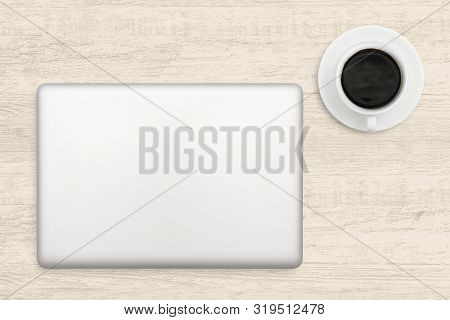 Laptop Computer And A Cup Of Coffee On Wood. Top View Business Background.