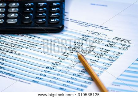 Accounting Business. Calculator With Accounting Report And Financial Statement