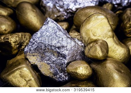 Gold And Silver Nuggets On Black Background. Precious Stones, Luxury Concept And Mineral Drainage. I