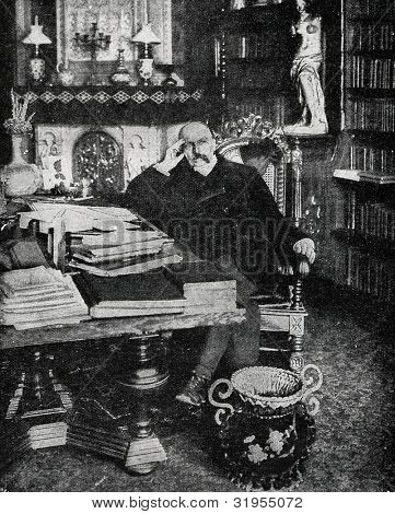 German writer Friedrich von Spielhagen in his office. Autotype by