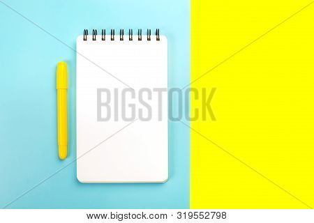 School Supplies On Yellow And Pink Background With Copy Space. Back To School Concept.
