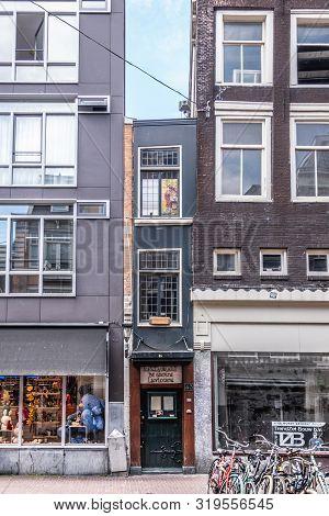 Amsterdam, The Netherlands - June 30, 2019: Smallest House And De Groene Lanteerne Restaurant In Haa