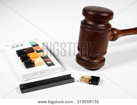 Morgantown, Wv - 29 August 2019: Juul E-cigarette Or Nicotine Vapor Dispenser Box With Judges Gavel