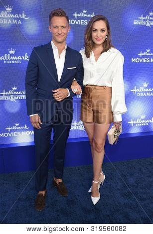 LOS ANGELES - JUL 26:  Nathan Johnson and Laura Osnes arrives for the Hallmark Channel and Hallmark Movies & Mysteries Summer 2019 TCA on July 26, 2019 in Los Angeles, CA