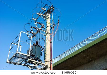 Electric pole on a blue sky background