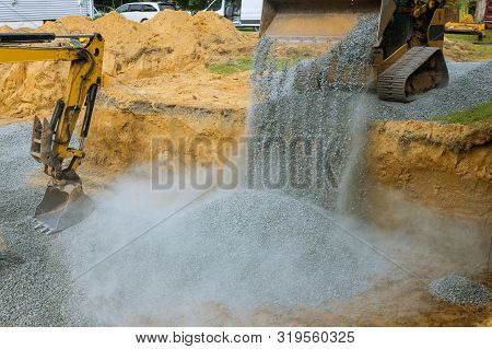 A Bulldozer On Wheels Buried A Excavator Bucket Working On The Building Under Construction Excavator