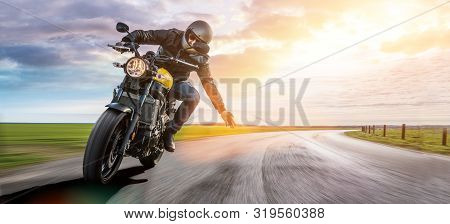 Man On Motorbike On The Road. Having Fun Driving The Empty Road On A Motorcycle Tour Journey. Copysp