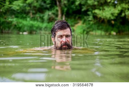Wild Man. Time To Relax. Bearded Man Swimming In Lake. Summer Vacation. Mature Swimmer. Brutal Hipst