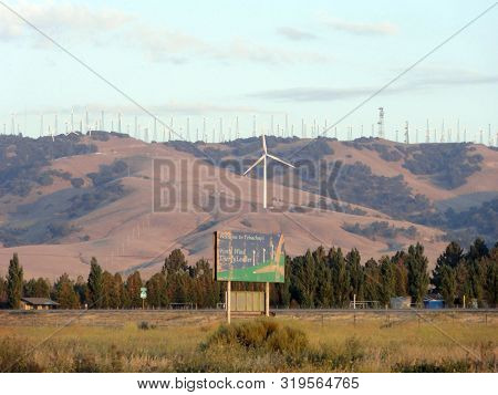 Tehachapi - August 1, 2011:  Welcome To Tehachapi World Wind Energy Leader Sign With Modern Windmill