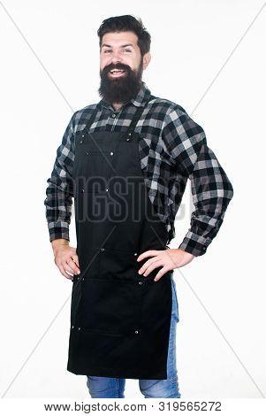 poster of Beard grooming salon. Well groomed macho barber. Uniform for barber salon. Barbershop concept. Hairdresser barber salon for men. Man brutal bearded hipster wear apron uniform. Barbershop staff