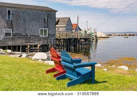 Adirondack Chairs Along The Coast In Nova Scotia