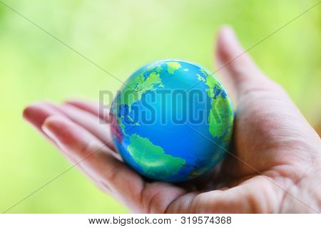 The World In The Hand With Nature Background / Hand Holding Globe With Map And Environment Green Pla