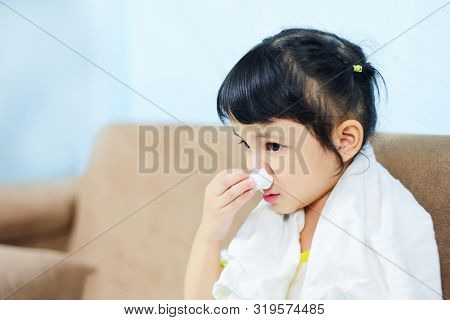 Asian Little Girl Sick Wrapped In Handkerchief Get Cold And Blow Nose The Flu Season / Child Runny N