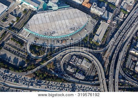 Los Angeles, California, USA - August 7, 2017:  Aerial view of LA Convention Center loading docks and busy freeways in downtown Los Angeles.