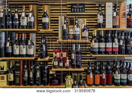 Porto, Portugal - May 30, 2018: Bottles Of Traditional Port Wine From Famous Producers On Display In