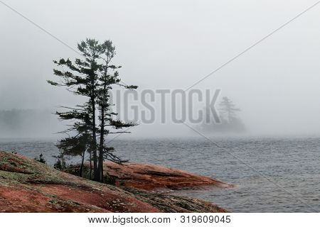 Image of Red Granite Coastline of the beautiful Georgian Bay on fogy day