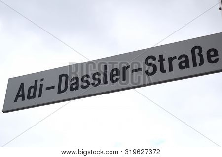 Herzogenaurach, Germany - August 19, 2019:  Street Sign Named After Company Founder Adi Dassler In F