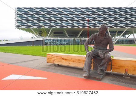 Herzogenaurach, Germany - August 19, 2019:  Bronze Statue Of Company Founder Adi Dassler In Front Of