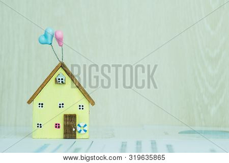 Home D?cor Driftwood Ideas, Real estate property investment for house on document contact for customer on table. Mortgage application form with miniature yellow model wood home. Residental planning poster