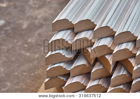 Joinery. Wood door manufacturing process. Stacked door moldings. Furniture manufacture. poster