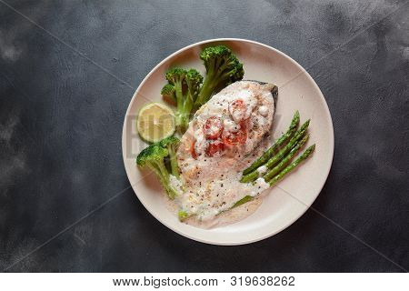 Creamy Garlic Butter Tuscan Salmon oven baked in a delicious lemon cream sauce with asparagus, cherry tomatoes, broccoli Healthy food Omega 3 Salmon in Creamy Dijon Sauce poster