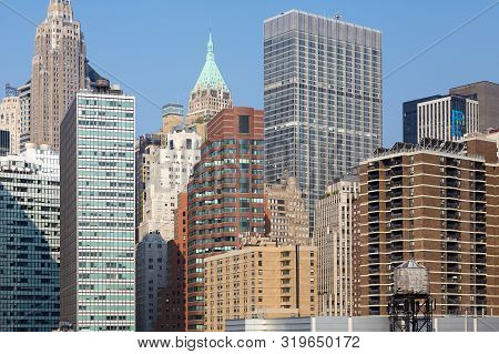Manhattan Cityscape With A Water Tower In Foreground, New York City, Usa.