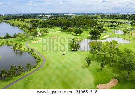 Aerial View Of Pound On Golf Course With Player, Footpath On Golf Course, Playr Enjoying The Game Un
