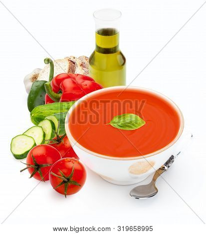 Bowl With Gazpacho And With Elaborate Ingredients Isolated On White Background. Tomato Soup For Summ