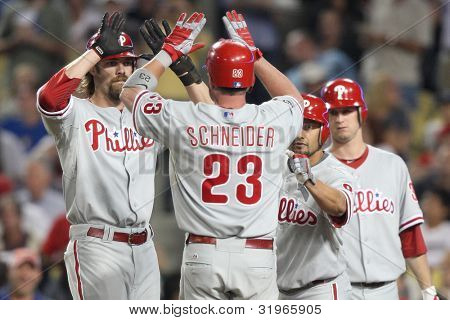 LOS ANGELES - AUG 31: Phillies catcher (23) Brian Schneider (mid) celebrates with teammates after scoring  during the MLB game on Aug 31 2010 at Dodgers Stadium.