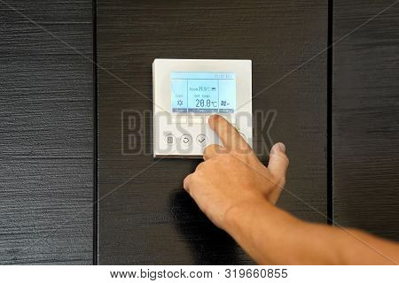 Male Hand Try To Turn On The New Air Condition In Room, In The Hotel Room. Caucasian Man Hands On Th