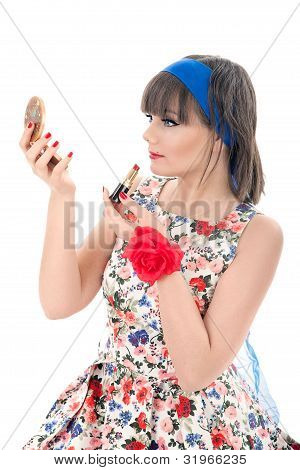 Beautiful Young Woman Looking At Hand Mirror