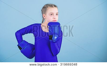 Contrary To Stereotype. Boxer Child In Boxing Gloves. Female Boxer Change Attitudes Within Sport. Ri