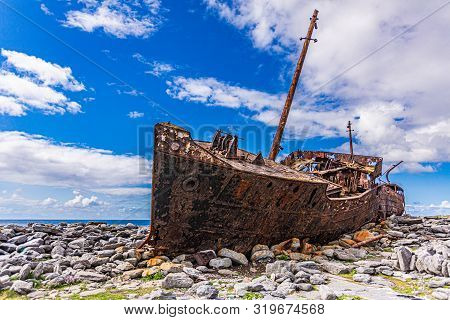 Plassey Shipwreck On The Rocky Beach Of Inis Oirr Island, Abandoned Ship, Old, Rusty With Time, Wond