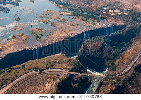 Spectacular Aerial Of Victoria Falls Waterfall And Bridge Across The Zambezi, Zimbabwe, Africa