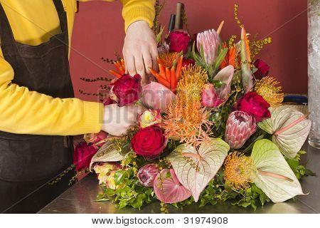 Florist arranging fresh flowers