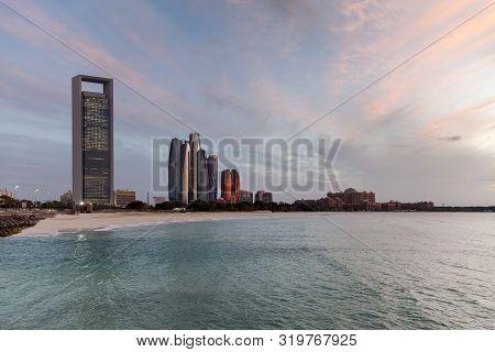 Serene Abu Dhabi Skyline At The Sunset