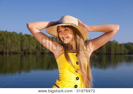 beautiful young woman on the sky and water