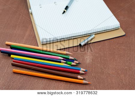 Blank Paper And Colorful Pencils On Old Wooden Table. Flat Lay, Top View.