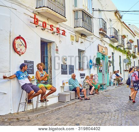 Tarifa, Spain - June 27, 2019. A Typical Street Of Whitewashed Walls In Tarifa Downtown. Calle De Lo