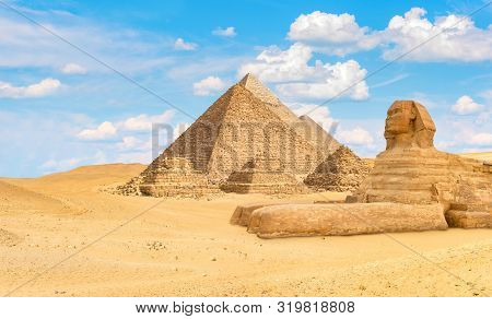Ancient Pyramids And Sphinx In The Desert Of Giza, Egypt