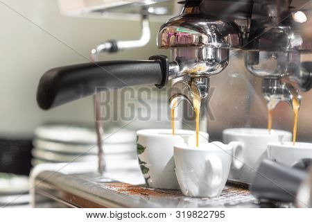 Espresso Pouring From Espresso Coffee Machine. Hot Beverages. Two Espresso Pouring From Espresso Cof