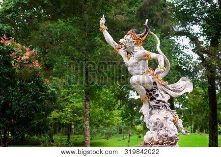 Ancient Statue Of Fighting Hanuman From Epic Hindu Legend Ramayana In Bedugul Botanical Garden. Trad