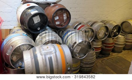 Real Ale Beer Barrels Stacked In Corridor At Old English Pub In Reading, Berkshire