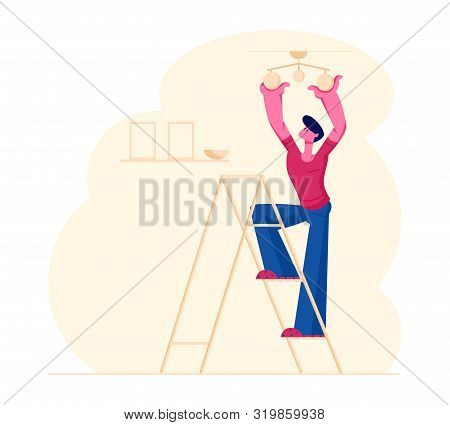 Young Man Housekeeper Standing On Ladder In Living Room Hanging Lamp On Ceiling Decorating Interior