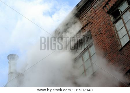 The old brick building was destroyed, smoke and steam from the windows.