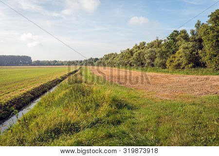 Agricultural Landscape In The End Of The Summer Season. The Photo Was Taken Near The Village Of Hank