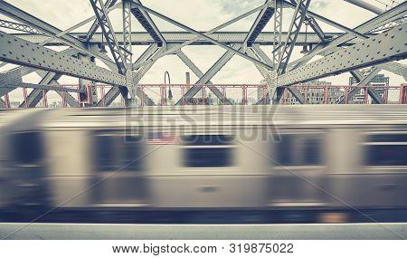 Williamsburg Bridge With Subway Train In Motion, Retro Color Toned Picture,  New York City, Usa.